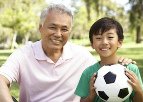 Grandson and grandpa playing soccer