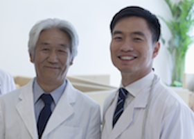 Portrait of three smiling doctors in the hospital