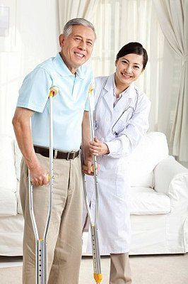 doctor assisting on walking with crutches